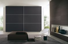 ANTA FILO DUE - Wardrobe with sliding doors with thin support in natural or brushed aluminium with a bar and polished or satin finish glass. Handle profile integrated in the support frame.  Proposed solution has dimensions of cm  322,5 x h 261,6 x d 65.  Available in different finishing and dimensions. - www.fimarmobili.com