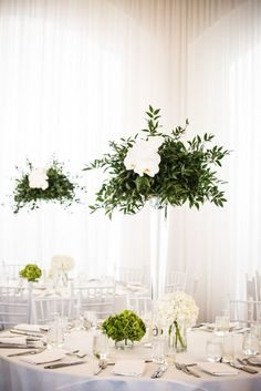 Orchid and olive branch centerpiece: http://www.stylemepretty.com/rhode-island-weddings/newport-ri/2016/11/09/elegant-modern-wedding-in-newport-rhode-island/ Photography: W Studios New York - http://wstudiosnewyork.com/