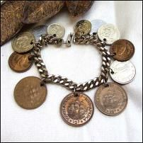 commemorative coins from one's travels?  everyone should have a travel charm bracelet in my opinion!