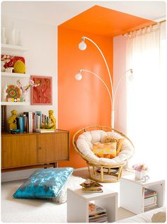 A colorful take on the mid century modern look—love that orange accented wall/ceiling (and everything else besides that blue pillow)