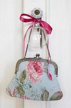 lovely vintage bag I would hang it on my bedroom door knob. My bedroom is shabby chic.