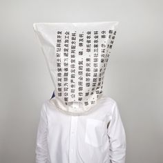 Oikonomo by Edson Chagas. Donning several types of plastic bags over his head, and wearing a plain and simple western-styled button-up shirt against an even more plain white background, Angolan. Photography Courses, Documentary Photography, Palazzo, University Of Wales, Plain White Background, Conceptual Fashion, African Artists, Art Festival, Life Drawing