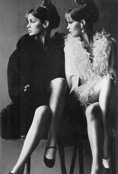 look | peer | peep | watch | sisters | friends | friendship | twins | feathers | fashion editorial | vintage | crossed legs | black and white fashion editorial | hair scroll | bun |
