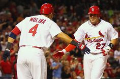 ST. LOUIS, MO - APRIL 18: Tyler Greene #27 of the St. Louis Cardinals is congratulated by Yadier Molina #4 also of the St. Louis Cardinals after hitting a two-run home run against the Cincinnati Redsat Busch Stadium on April 18, 2012 in St. Louis, Missouri. (Photo by Dilip Vishwanat/Getty Images)