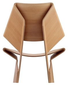 Folding Wood into a chair by Grete Jalk