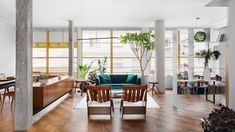 Brazilian designer Ana Sawaia has renovated a São Paulo apartment in an iconic building, introducing a broken-plan interior filled with vintage furniture and colourful patterned surfaces. Saunas, Apartment Renovation, Apartment Interior, Sauna Seca, Painted Window Frames, Condominium Interior, Living Room Bookcase, Green Velvet Sofa, Sauna Room