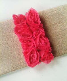 Love the canvas clutch with the bright pink ruffle!