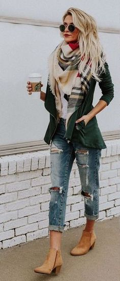 Street style, great combination of pieces, the dark green jacket brings it all together.
