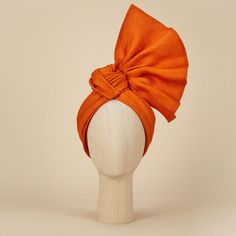 Adding a pop of colour to the spring/summer collection, Eastern Sunset is an elegant turban crafted from zesty-orange linen straw. The stylish piece delicately frames the face and looks fabulous with cocktail dresses and kaftans alike. Mode Turban, Turban Hat, Turban Style, Turban Headbands, Hair Wrap Scarf, Hair Scarf Styles, Fascinator Hats, Fascinators, Headpieces