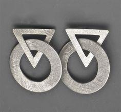 7E60 | Interlocking silver triangle and circle | $150
