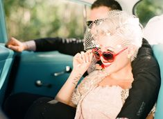 Fabulous Vintage DIY wedding. bride and groom in vintage car with the cutest rockabilly dress and sunnies.