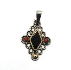 Pendant in sterling silver, gold, coral and jet. Handmade in Galicia with traditional methods. Artcraft of The Way of St.James. Tax free $48.90
