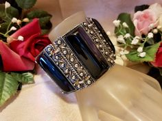Vintage Retro Very WIDE Black Thermoset Lucite Plastic Panel Floral Silver Tone Bracelet by SparklesGalorebyDeb on Etsy https://www.etsy.com/listing/546997554/vintage-retro-very-wide-black-thermoset