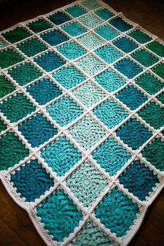 Granny square blanket!  Made with 'I Love This Cotton' from Hobby Lobby; 5.5mm hook.  Sunburst Granny pattern. #crochet #afghan #crochetafghan #crochetblanket