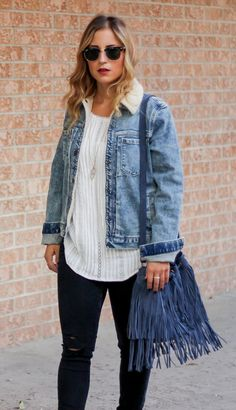 Fall outfit idea - Gap denim sherpa jacket, white peasant blouse, black skinny jeans from Zara and a Brave Leather fringe bucket bag