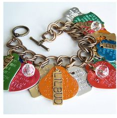 Pet tags bracelet .....I was just wondering what to do with all of these!  @Crystal Dunn & @Robyn Arouty
