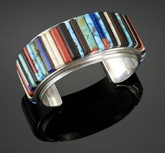 Cuff   Charles Loloma.  Sterling silver with Kingman turquoise, Mediterranean coral, fossil ivory, ironwood and lapis.