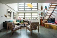http://www.apartmenttherapy.com/video-house-tour-a-converted-taxi-garage-in-paris-230790