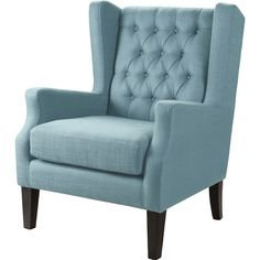 Showcasing blue button-tufted upholstery, this lovely arm chair is perfect anchored atop a bold rug in your living room or den.  Pro...