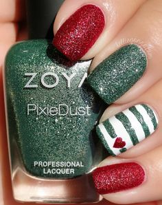 Love these Christmas stripes! | #christmasnails #nailart #christmasnailart #xmasnails