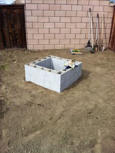 Fire pit under 30$. 16 cinder blocks (16x8x6) and 8 cinder block toppers. I used nail glue to hold the blocks together and filled with lava rock to create a base. Fill the blocks with sand or rock to absorb the heat.