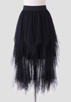 Whimsical and dramatic, this black midi skirt is designed with cascading tiers of tulle and an asymmetrical hem. Complete with an elastic waistband for the perfect fit, this semi-sheer skirt can ...