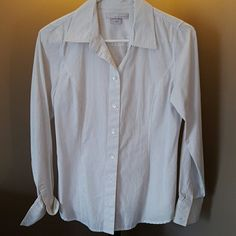 Old Navy white button down White button down shirt with black pinstripes. Slightly tapered seams for a more feminine fit. Good condition. No flaws. Perfect for work. Please see The Limited pants in my closet for a perfect work outfit! Old Navy Tops Button Down Shirts