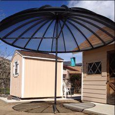 Yard umbrella made from satellite dish.