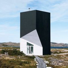 on fogo island a small island in newfoundland canada. this is the artist dwelling tower studio created by @saundersarchitecture for a project of the #fogoisland arts corporation. the studio can only be reached by hiking along the shore along a boardwalk.  see more #architecture on #designboom! by designboom