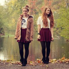 Graphic loose crop top with elbow-sleeves // High-waisted burgundy skater skirt // Black stockings // Brown parka // Black fringe boot heels