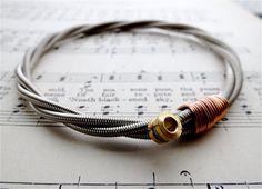 Recycled bass guitar string bracelet.