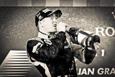 Kimi celebrates on the podium. Australia 2013. Has to take a drink first!