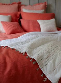 The Juno quilt and coral linen bedding from Natural Bed Company