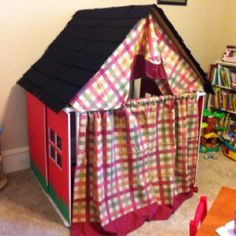 Kids playhouse - used PVC pipe, cardboard roof with felt shingles, foam board, kitchen curtains, and construction paper grass.