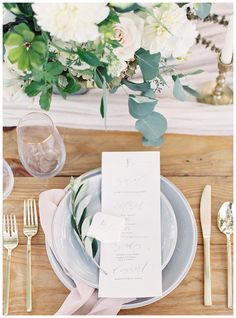 Place setting of dove gray china with with modern gold flatware, blush napkin and calligraphy menus. Calligraphy by Olde York Station, florals by Nectar. Image by Allison Kuhn Photography.