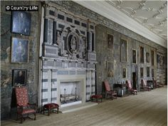 The long gallery with its huge Elizabethan marble fireplaces, hangings and portraits at the New Hall at Hardwick Hall. The house was built in 1590-7 for Bess of Hardwick Hall with alterations carried out in 1788 and a service wing added in 1860. Chesterfield, Derbyshire, England.