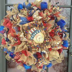 Uncle Sam Patriotic American Country Burlap and Deco Mesh Wreath Classic homespun burlap look with a modern burst of deco mesh color.