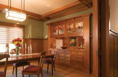 Traditional arts and crafts dining area, note boxed design on ceilings. Pocket door, mission style pendant light fixture.
