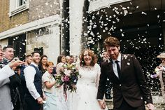 Bride & Groom Confetti portrait - Image by Babb Photo - A London Autumnal wedding at the Londesborough pub in Stoke Newington with a bespoke wedding dress and photography by Babb Photo. The Office Wedding, Registry Office Wedding, Pub Wedding, Wedding Send Off, Wedding Exits, Wedding Photos, Mismatched Bridesmaid Dresses, Wedding Dresses, Fall Bouquets