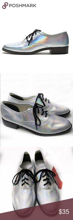 New American Apparel Metallic Dancing Shoe New with tags American Apparel Metallic Dancing Shoe. Hologram silver loafer style shoes. Size 6. American Apparel Shoes Flats & Loafers