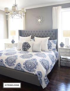 beautiful bedroom decor | tufted grey headboard | mirrored