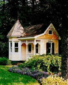 Victorian style playhouse with turret.