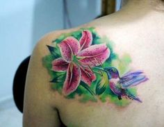 Lily tattoos are some of the most adorable tattoos. The tattoos are very elegant in their display and they tend to have a unique appearance. Hawaiian Flower Tattoos, Lily Flower Tattoos, Flower Tattoo Foot, Flower Tattoo Shoulder, Tattoo Sleeve Designs, Flower Tattoo Designs, Sleeve Tattoos, Wrap Tattoo, Back Tattoo
