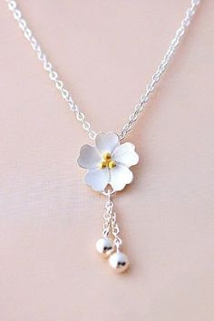 Cute Sterling Silver Sakura Blossom Necklace Light up your look with this adorable sakura flower necklace. Dangling silver accents add an eye-catching sparkle, and the simple style makes this a necklace that will fit with any lifestyle. Cute Jewelry, Body Jewelry, Jewelry Necklaces, Gold Bracelets, Chain Bracelets, Bracelet Charms, Jewelry Logo, Jewellery, Coin Pendant Necklace