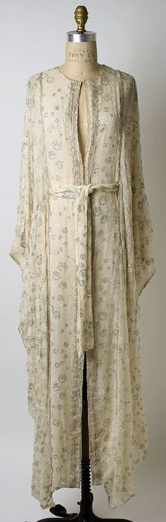 Thea Porter  (British, Jerusalem 1927–2000 London) White Dress Date: 1970s Culture: British Medium: silk, plastic, metallic thread Dimensions: Length at CB: 56 in. (142.2 cm) Credit Line: Gift of Eleanor Lambert Berkson, 1980