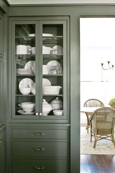 Nashville Idea House Tour   Every Southern kitchen needs a spot to display china. Our glass-front cabinets flank the opening to the dining room for easy access. #homeideas #southernliving #curbappeal #porchdecor