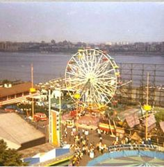 Palisades Amusement Park in New Jersey, closed in 1971 for development of boring apartment buildings. The West Side of Manhattan can be seen across the Hudson River. Many many New Yorkers went there every year.