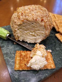 Mozzarella Cheese Ball    8 oz package cream cheese, softened  1/2 package (4 1/2 tsp) dry ranch dressing mix  1/3 cup mayonnaise  2 cup shredded mozzarella cheese  finely chopped pecans    Combine first 4 ingredients in a bowl.  Mix well.  Form mixture into a ball and roll in chopped pecans.  Refrigerate before serving with crackers.