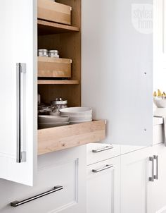 All-wood custom pullout storage allow for easy access in the kitchen. {Photography by Donna Griffith}