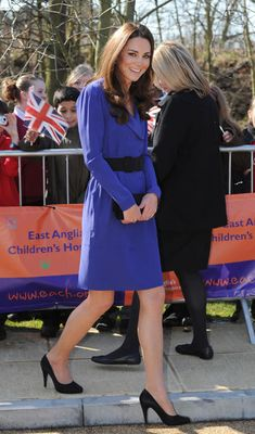 Confident Kate charms in blue with her debut public speech
